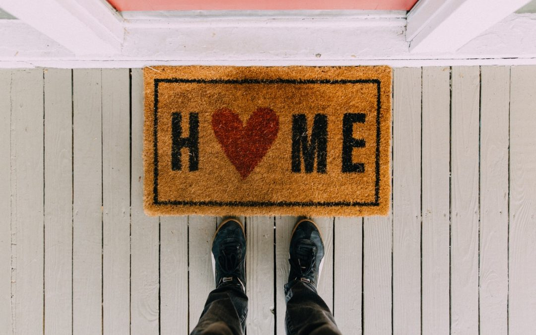 welcome mat at front door that says home