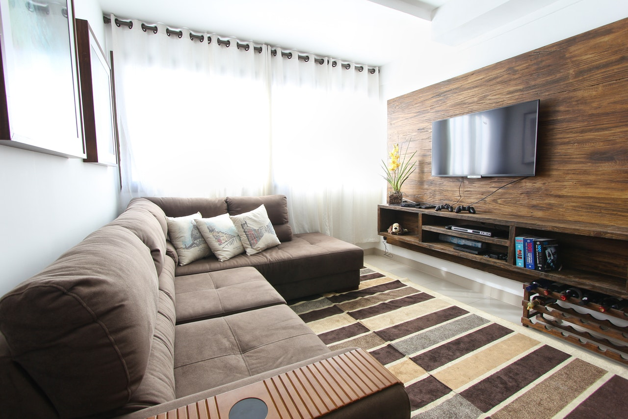 Condo living space with couch and tv and console